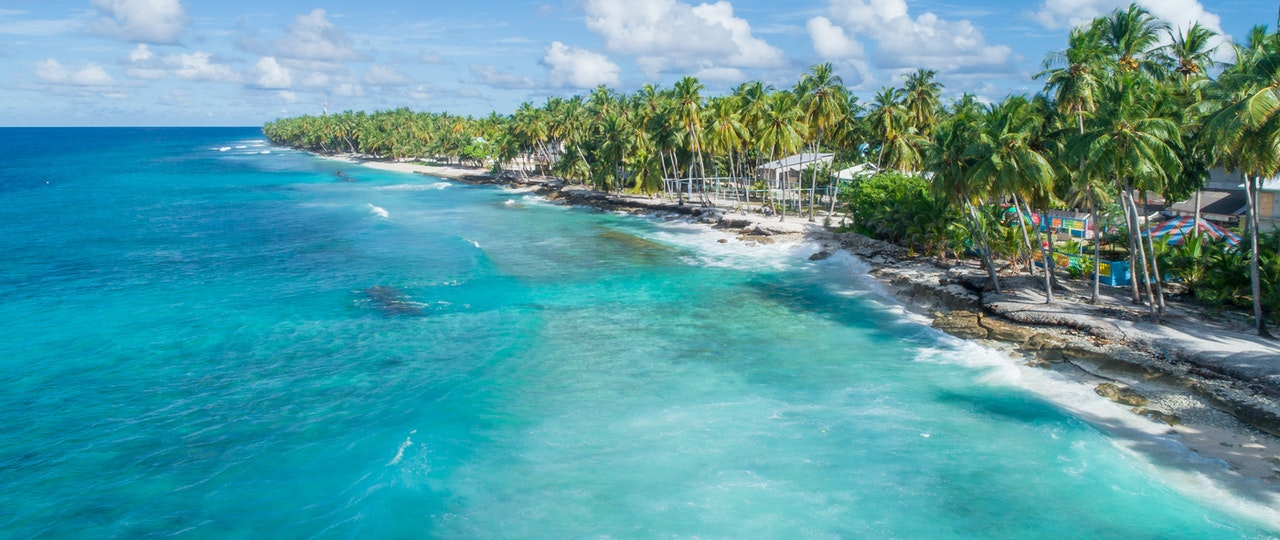 https://www.pexels.com/photo/aerial-view-of-white-sand-beach-1266831/