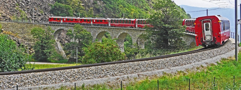 red-train-on-black-steel-train-rail-during-day-159252